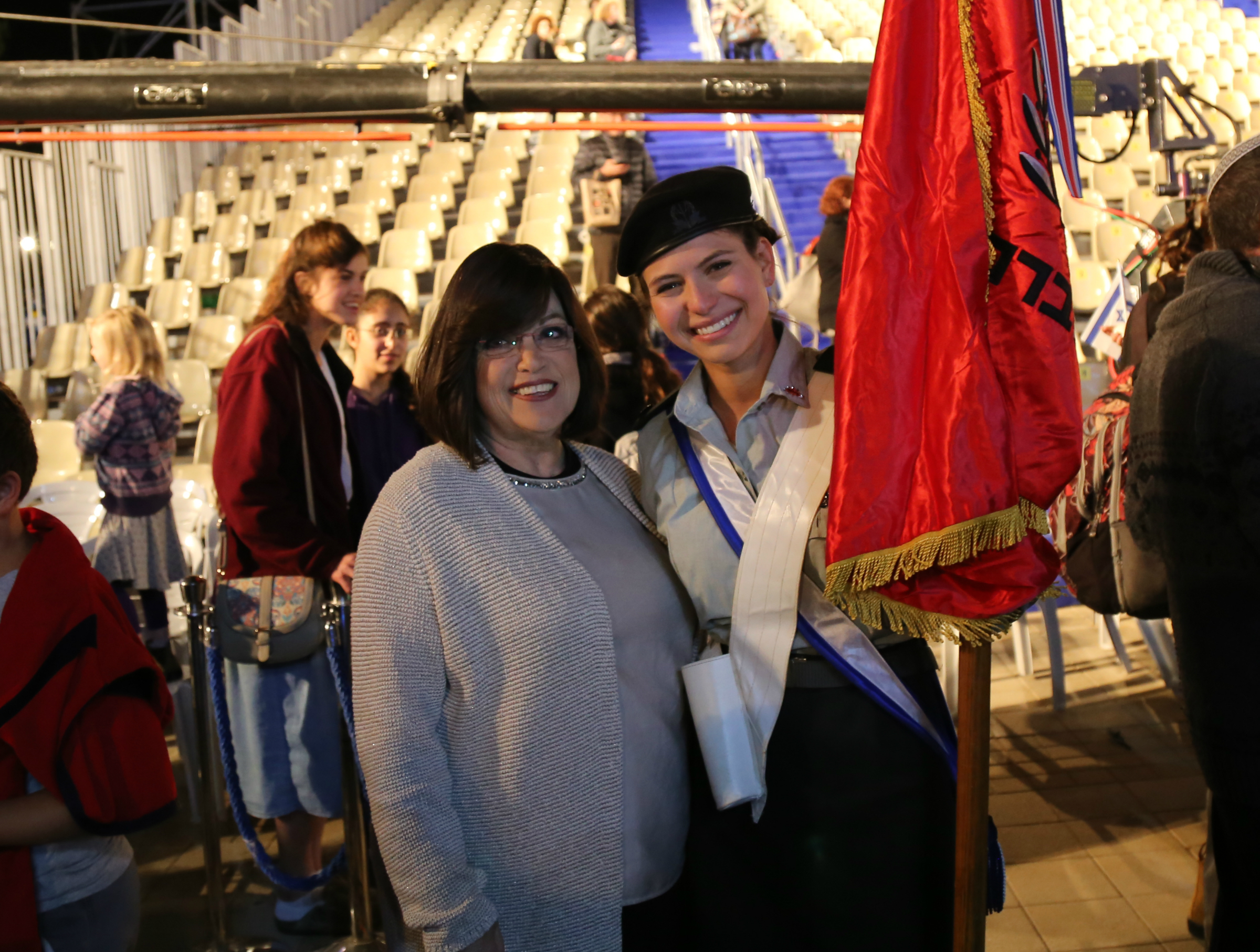 Miri Ehrenthal with a soldier at Israel independence day lighting of the torch ceremony